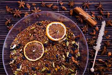 Rooibos tea with dry orange slices in plate