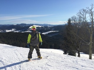 boy on the hill with snowboard