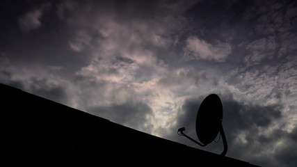 Movement of cloud rainy, satellite dish on foreground.