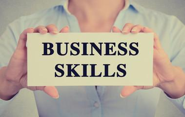 Closeup businesswoman hands sign business skills message