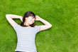 young asian woman lying on the lawn