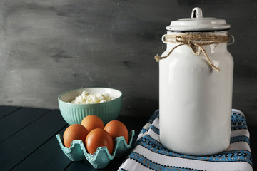 Milk can with bowl of cottage cheese and eggs