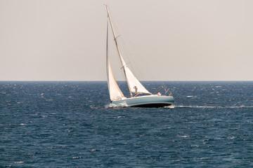 Sailing Vessel in Deep Blue Ocean