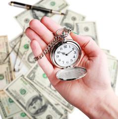 Silver pocket clock in hand
