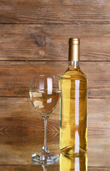 White wine on table on wooden background