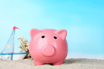 Piggy bank on the beach