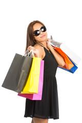 Asian Female Shopping Bags At Camera Half Tilt