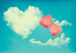 Retro Holiday background with heart shaped cloud on blue sky and