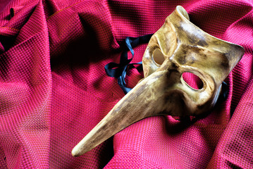 Classic carnival mask over red cloth