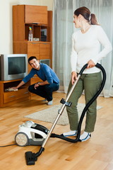 Happy couple doing housework together