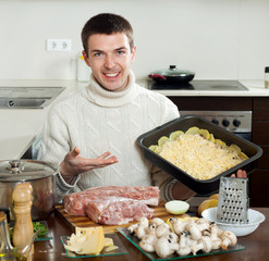 Ordinary man cooking french-style meat at home