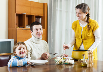 family of three having lunch at home