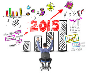 Business man looking success with profit concept in year 2015