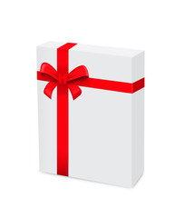 Gift box wrapped with red ribbon on white background.