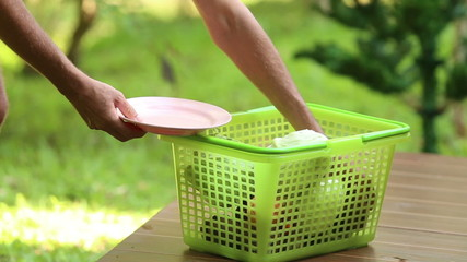 man chooses from a basket plate of cabbage for cooking tradition