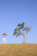 People and lonely tree