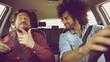Two friends having a lot of fun dancing in car
