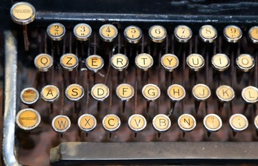ancient black rusty typewriter with white keys