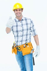 Male handyman gesturing thumbs up sign