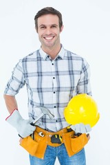 Happy handyman holding hammer and hard hat