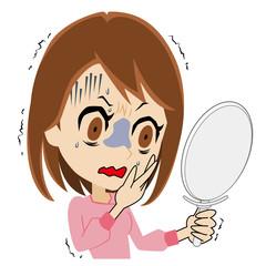 鏡を見て怯える若い女性