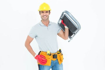 Confident worker carrying step ladder