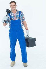 Portrait of plumber holding plunger and tool box