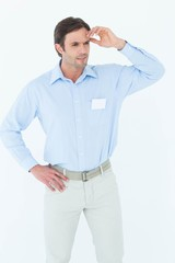Businessman with hand on hip looking away