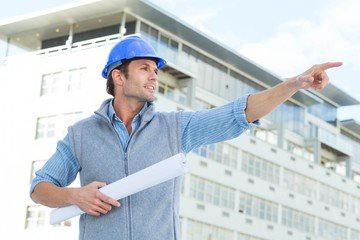 Architect with blueprint pointing away