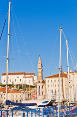 Piran harbor,bell tower and Tartini square in background,Istria