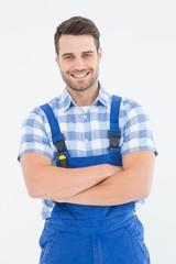 Male handyman standing arms crossed