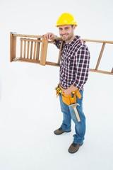 Confident handyman carrying ladder