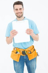 Construction worker showing blank paper on clipboard