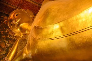Reclining of gold buddha