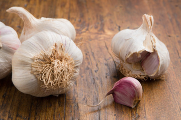 garlic with clove on a wood table