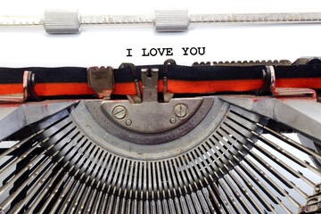 written typewriter I LOVE YOU with black ink