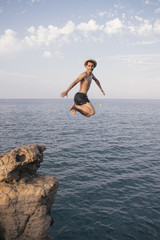 A man is dipping from a high cliff
