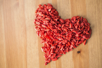 Heart shaped goji berries on a table