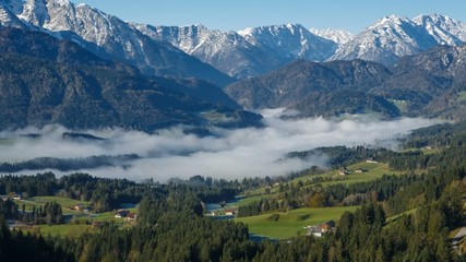 Morning fog in the Austrian Alps