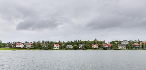 Reykjavik colorful houses near pond, Iceland