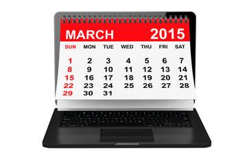 March calendar over laptop screen