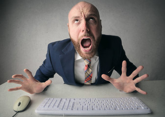 Angry businessman typing