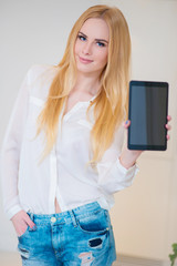 Attractive Woman Showing her Tablet at the Camera