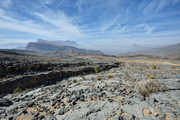 Rocky terrain with mountains