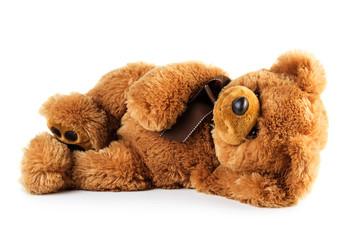 Toy teddy bear lying