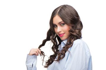 Seductive young woman in a man shirt