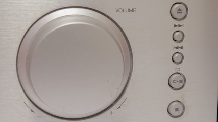 Turning a volume knob up and down
