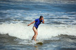 young woman surfing