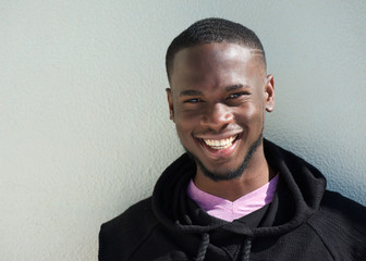 Close up portrait of a cheerful young black man smiling