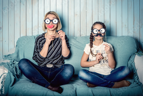 Mom and daughter with false mustaches - 77143977